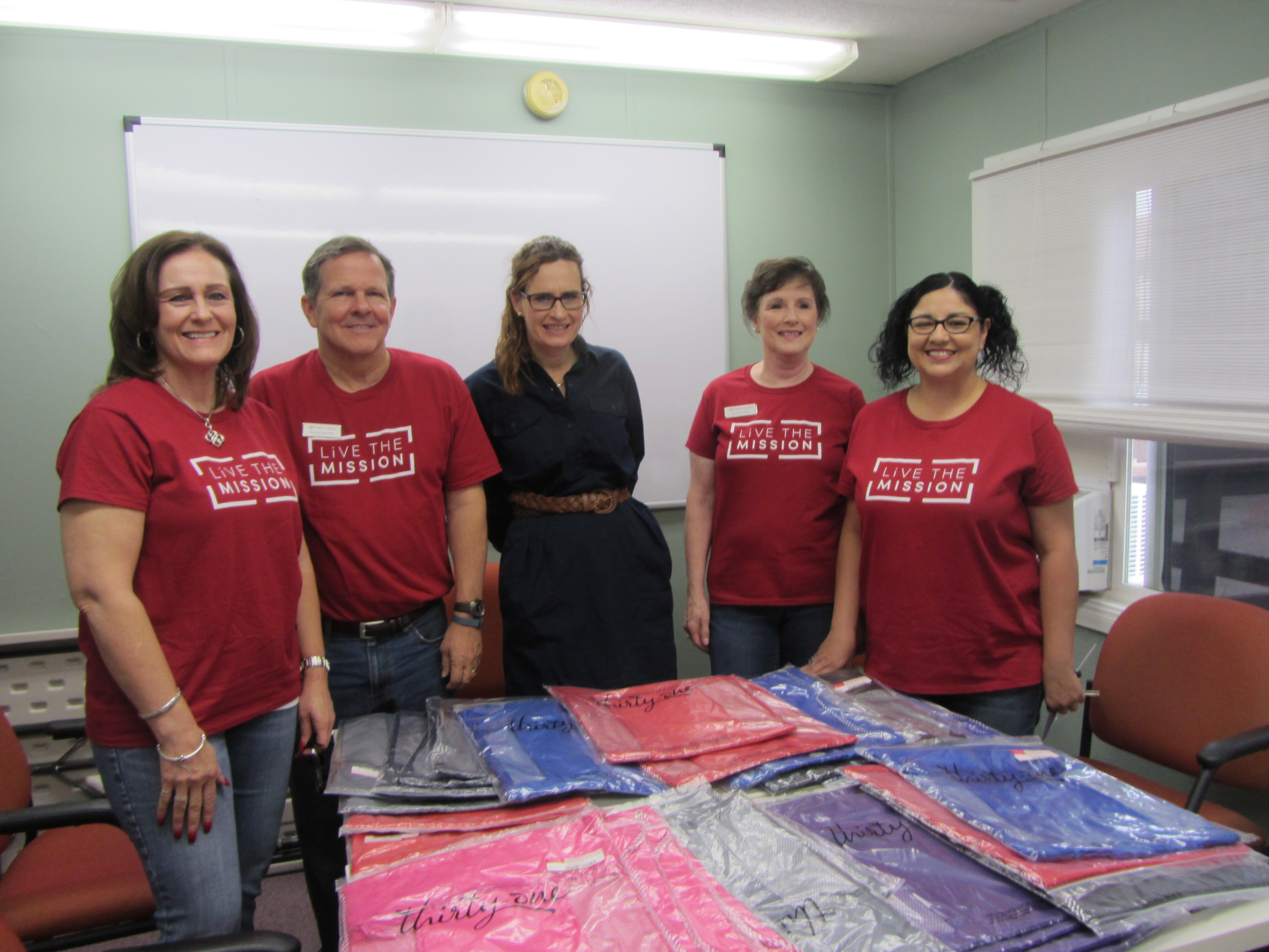america s christian credit union supports local schoolchildren photo captions accu staff children at dream center backpack drive accu staff jennifer hicks middle executive director of nhh