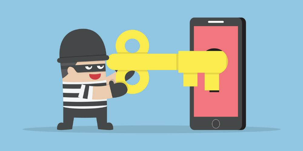 bigstock-Thief-Or-Hacker-Hacking-Smartp-102083159