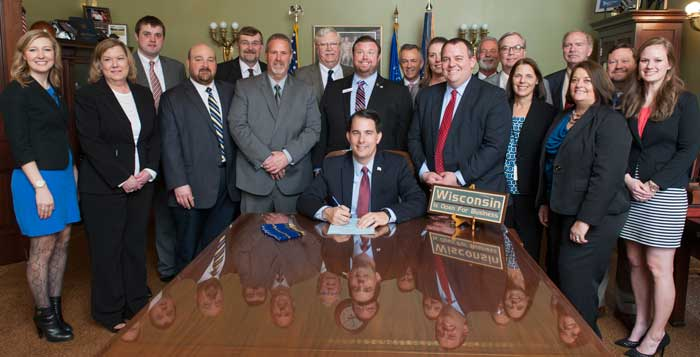 Governor Scott Walker Signs Credit Union Legislation Into Law