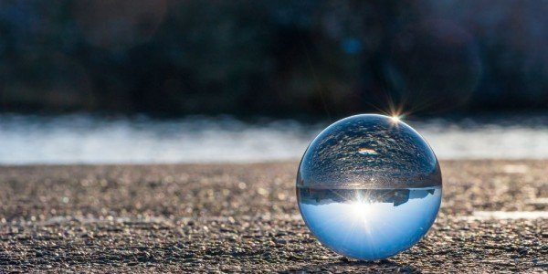 bigstock-Glass-transparent-ball-on-dark-83992238-e1458933275392