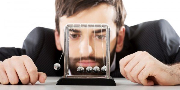 bigstock-Man-moving-newton-balls-in-off-116608790-e1458932246740