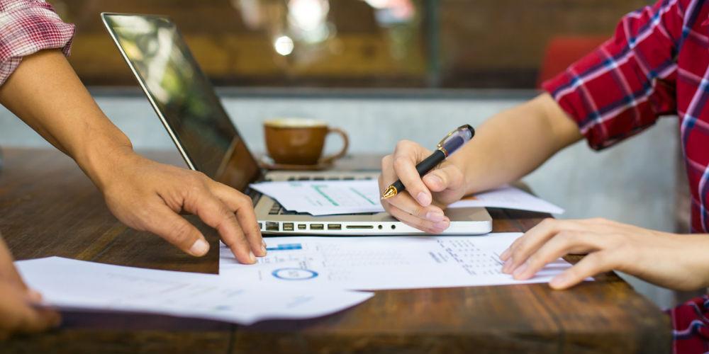 bigstock-Businesspeople-Reviewing-Docum-119010155.jpg (1000×500)