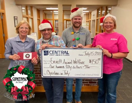 """Central Credit Union of Florida donates to local charities during """"Christmas in July"""""""